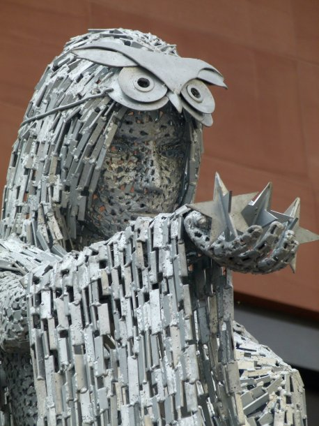 Sculpture made of fragments of metal, masked goddess holding out stars