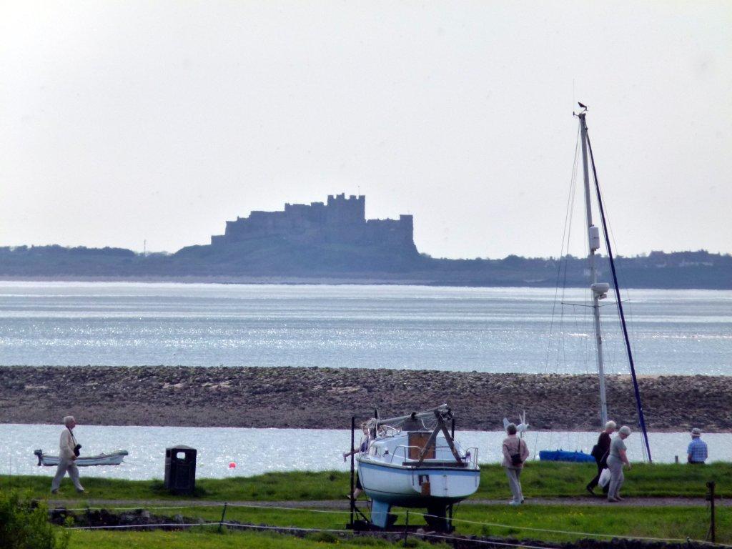 Bamburgh Castle across the bay