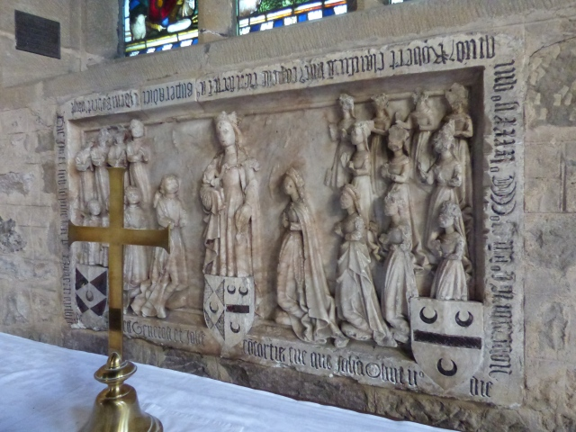 Reredos, depicting the Virgin and Child and the large family of Robert and Joan Gylbert.