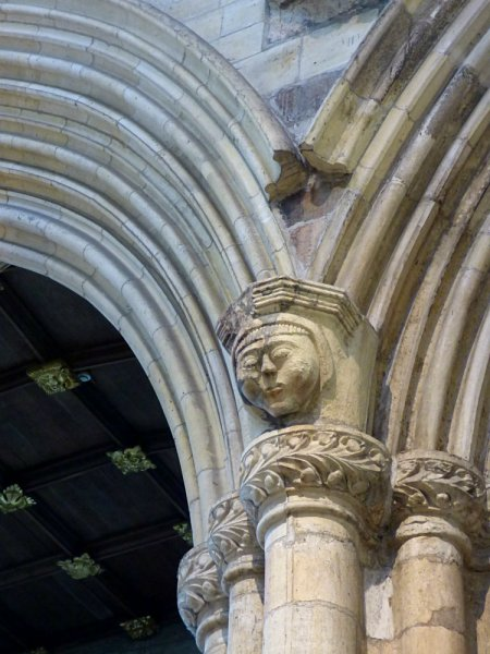 Details and curious characters cover the stonework