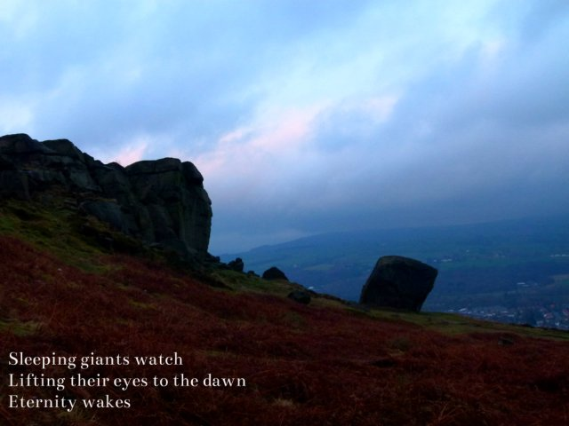 Sleeping giants watch, lifting eyes to the dawn, eternity wakes