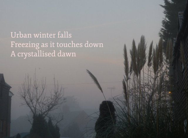 Urban winter falls Freezing as it touches down A crystallised dawn