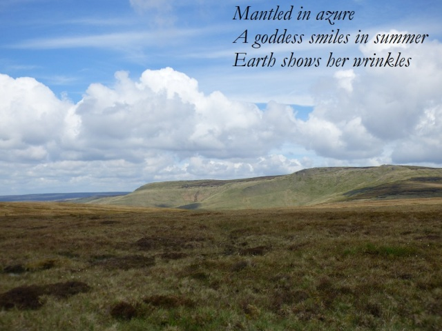 Mantled in azure a goddess smiles in summer earth shows her wrinkles