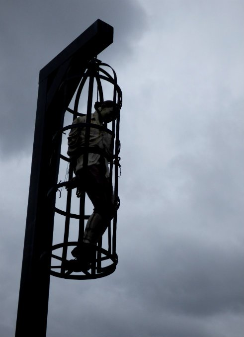 Caged hung figure #writephoto