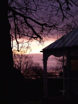 summerhouse silhouetted against a dawn sky