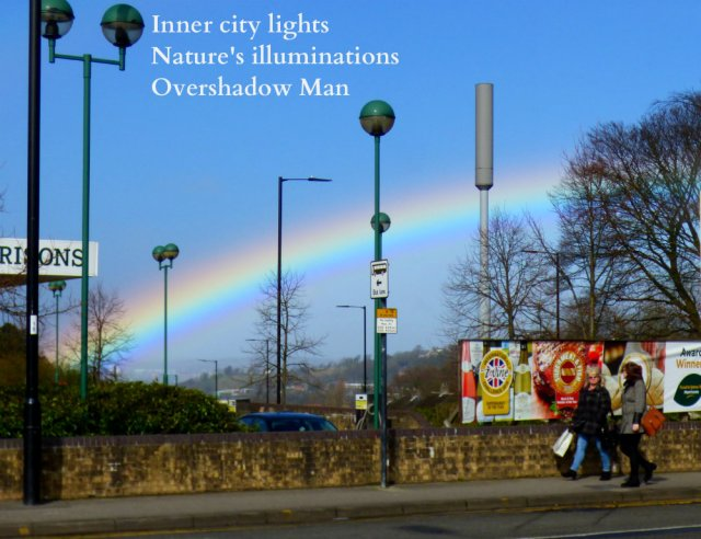 rainbow over the city streetlights