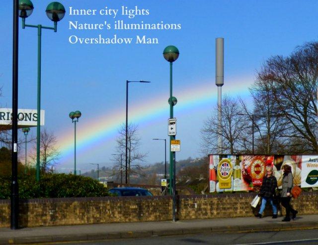 rainbow over the city streetlights