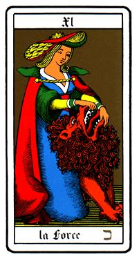 Tarot card 'strength' showing a woman calmly holding open the mouth of a lion