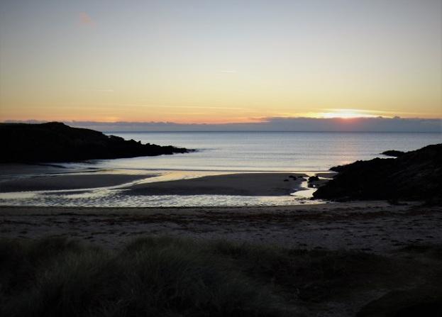 sunset over a sea cove